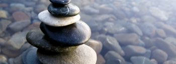 Zen rocks stack in shallow water